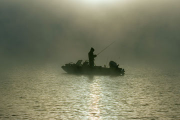 fisherman silhouette on a foggy Georgia morning