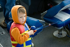 fisher boy wearing lifejacket