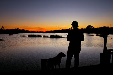fisherman and dog silhouette - South Carolina sunset