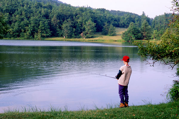 boy fishing in lake, Blue Ridge Mountains, Virginia